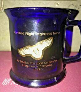 "BLUE-GLASS & GOLD COMMEMORATIVE COFFEE MUG;""CERTIFIED FLIGHT REGISTERED NURSES""."