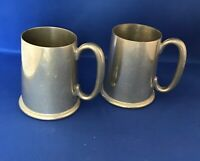 A Matched pair of Walker & Hall half pint pewter tankards.  In good condition.
