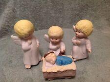 Vintage Ceramic Angels with Baby Jesus in a Manger 4 Pc set