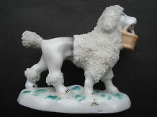 C1860S VINTAGE STAFFORDSHIRE MINIATURE POODLE WITH BASKET IN MOUTH