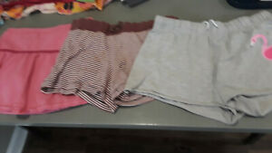Pink skort, brown and white striped shorts, gray shorts with flamingo