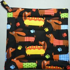 Deluxe Hot Pad/ Pot Holder: Dachshunds Hot Dogging: Colorful on Black: Quilted