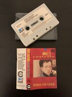 ELVIS COSTELLO AND THE ATTRACTIONS - PUNCH THE CLOCK (UK CASSETTE TAPE)
