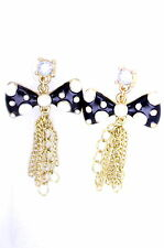 Cute black and white enamel bow stud with gold colour tassel