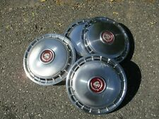 Factory metal 1985 to 1988 Cadillac Deville 14 inch hubcaps wheel covers