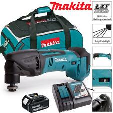 Makita DTM50Z 18V Oscilante Multiherramienta Con 1 X 4Ah BL1840, DC18RC y LXT400 Bolsa