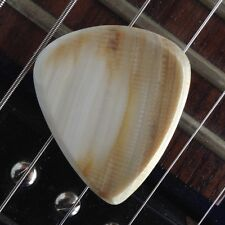 Real SEASHELL GUITAR PICK- classic shape, 2.3mm thick, sharply tapered edges.
