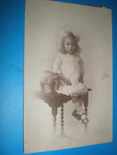 Old  postcard girl with toy elephant c1910s