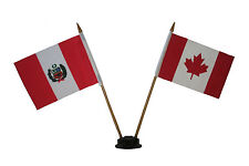 "CANADA & PERU 4"" X 6"" DOUBLE STICK FLAG WITH BLACK STAND ON 10"" PLASTIC POLE"