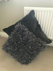 """Two grey cushions, one plain, one detailed, 22"""" & 17"""""""
