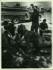 1990 Press Photo Firefighters check supplies by fire truck in Alabama