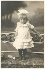 Young Child Posing With Her Dropped Porcelain Doll On The Floor ~ RPPC c.1910