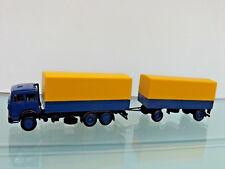 Herpa 309578 - 1:87 - Iveco Magirus Tarpaulin/Roadtrain, Yellow/Blue -