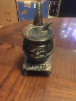 "pot belly stove ashtray, vintage. 5.5"" tall, heavy great paperweight"