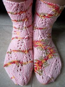 Hand knitted lace pattern socks, pink with red, yellow and olive