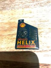Shell Helix Plus 15W-50-Metal Keyring in plastic-New-1990's-Superior Protection.