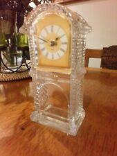 Quartz clock set in glass mantle stand very elegant
