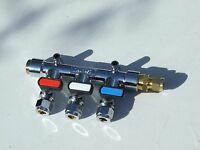 Gas Manifold 3 way with straight inlet to 10mm copper pipe and end plug.