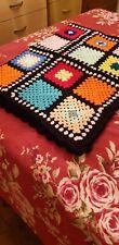Multi Coloured Black Edge Medium Crochted Blanket.
