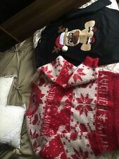 two size small christmas jumpers