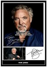 225.    TOM JONES  SIGNED  A4 PHOTOGRAPH