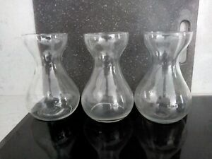 3 matching glass vases