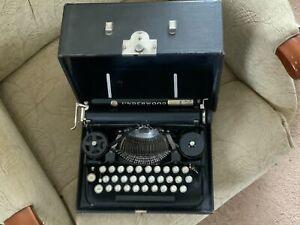 Antique Underwood standard portable typewriter with case