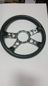 GRANT 4 SPOKE WITH HOLES 9 BOLT SIGNATURE SERIES 14 INCH BLACK LEATHER WHEEL