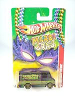 2011 Hot Wheels Mardi Gras COMBAT MEDIC Purple 3/6 NEW NOC with Protector Pak