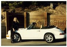 COLOR PHOTO I_9606 PRETTY WOMAN SITTING ON SIDE OF CONVERTIBLE