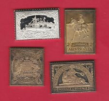 FOUR WORLD SILVER STAMP INGOTS IN NEAR MINT CONDITION