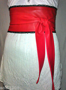 RED FAUX LEATHER OBI CORSET BELT WITH BLACK FRILL.
