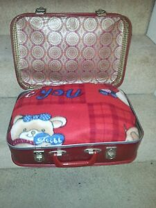 Small red suitcase pet bed. Very small dog. Teacup chihuahua. Portable