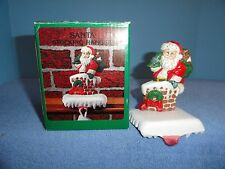Cast iron Santa in chimney stocking holder hanger