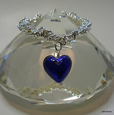 Stretchy link charm bracelet with royal blue 20 mm lamp work glass heart