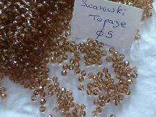 Stop affaire  60 perles à facettes  en cristal de Swarovski  topaze 5 mm