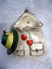 A vintage Hummel Goebel pottery wall pocket Knapsack with a hat & some cherries