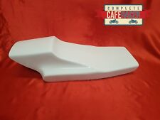 TRACKMASTER WITH CAT EYE STYLE FIBREGLASS CAFE RACER SEAT FINISHED IN WHITE