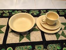 Fiestaware  plate bowl cup & saucer four piece set in Yellow