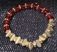 Gorgeous red and silver tone beaded bracelet elasticated.