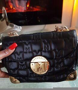 Metrocity Black Mini crossbody bag Authentic Rare Bag..