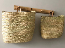 basket in straw and leather, decorative wall storage