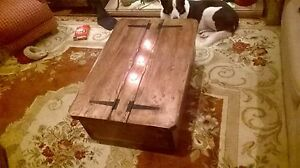 Le Morbihan a rustic storage coffee table with a gull wing lid