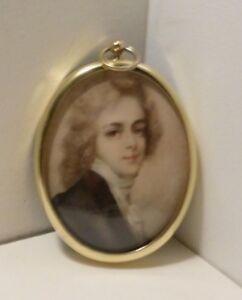 Miniature of young Georgian gentleman framed in a brass bezel.