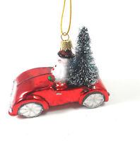 Silver Tree Hand blown Glass Snowman in a Red Car Christmas Ornament