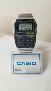 Vintage Casio Databank DBC-1500 Calculator Men's Silver Digital Watch w/ manual