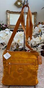 NWT Coach Signature Orange Spice Getaway Nylon File Bag Cross-body F77408, $128