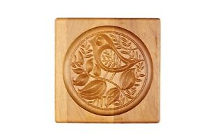 Carved form for gingerbread. Bird on a branch .Wooden cookie cutter