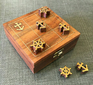 Wood & brass noughts & crosses nautical anchors & helms travel game set