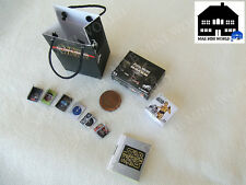 Star Wars. Miniature Force Day set.Console,videogame, book and bag. Scale 1/12